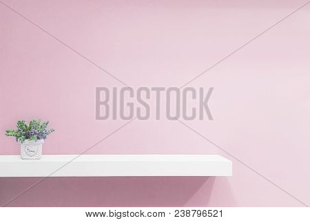 Empty White Shop Shelf, Retail Shelf On Pink Vintage Background.