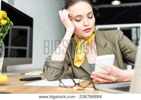 Beautiful Stylish Mid Adult Businesswoman Using Smartphone At Workplace