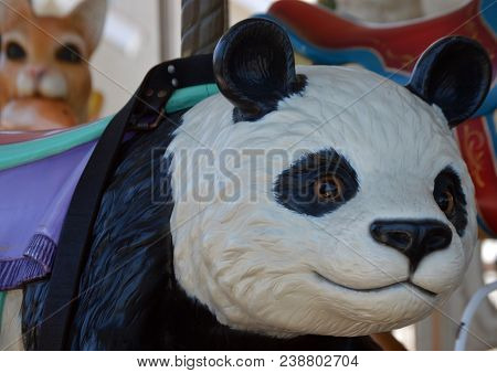 Black And White Panda Face Of Carousel Merry Go Round Ride