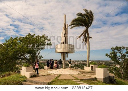 Santa Clara, Cuba - December 10, 2017: Monument Of The Lomo Del Capiro In Santa Clara With Tourist I