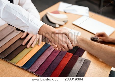 The Seller Shows Samples Of Materials For Furniture. A Young Couple Came To A Furniture Store. Men S