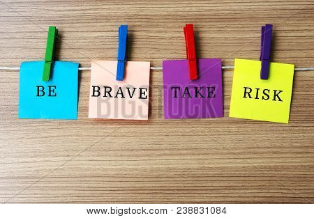 Inspirational Quote - Be Brave Take Risk On Notes Hanging By Clothespins