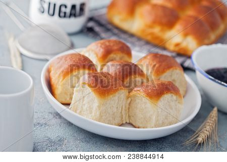 brioche buns with some ingredients on kitchen's table - food and drink
