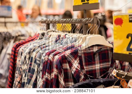 Clothes Hang On A Shelf . Cloth Hangers With Shirts. Men's Stylish Clothes