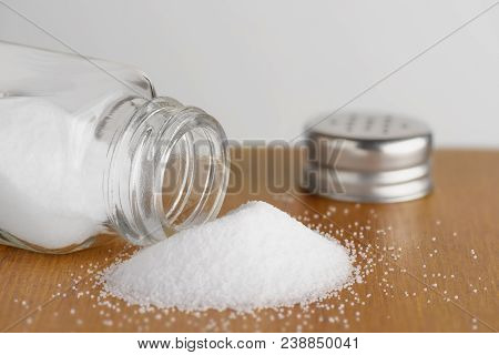 Photo Of Salt Shaker On Wooden Table