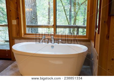Soaking Bath Tub In A Cabin In The National Forest. This Bathtub Is Oversized And Luxurious.