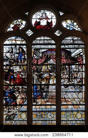 PARIS, FRANCE - JANUARY 04: Stained glass window in the church depicts The Parable of Those Invited to the Wedding Feast, Saint Etienne du Mont Church, Paris, France on January 04, 2018.