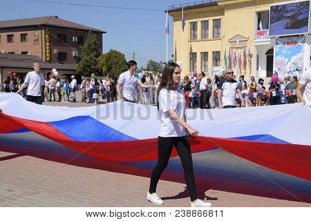 Slavyansk-on-kuban, Russia - May 1, 2018: Solemn Carrying Of The Flag Of Russia By Area. Celebrating