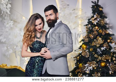 Young Fashion Couple Celebrate New Year And Christmas Holiday. Pretty Beautiful Woman And Her Handso