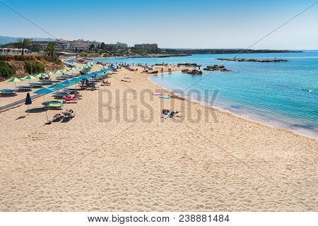 Beautiful View Of Beach Umbrellas And Sunbeds On A Coral Bay Beach In Paphos, Cyprus.