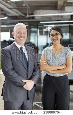 Portrait Of Smiling Male Chief Economist And Female Accountant. Positive Mature Man In Suit And Youn