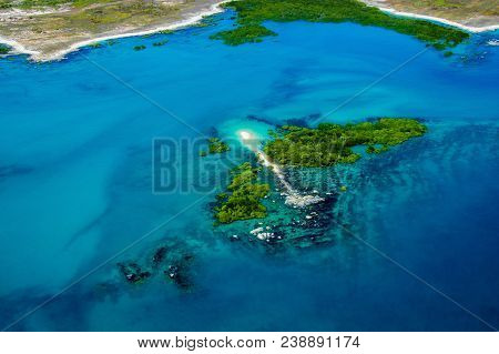 Island Aerial Photography. Aerial Photo Of Body Of Water.