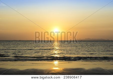 Beautiful Sunset Over Sea And Tropical Beach In Summer Time. Natural Background Of Sunset Dawn And S