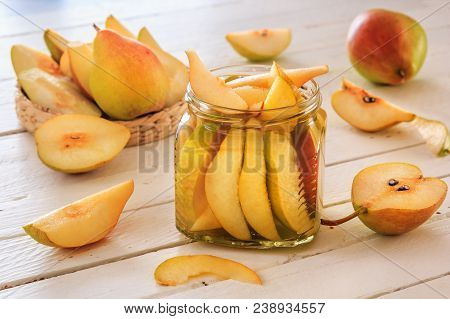 Cocktail Of Pears, Pear Slices In Syrup, Fresh Pears And Sliced Pears On White Wooden Boards