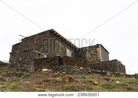 Azerbaijan, Khinalig mountain settlement view, houses of local residents. Located high up in the mountains of Quba Rayon, Azerbaijan. poster