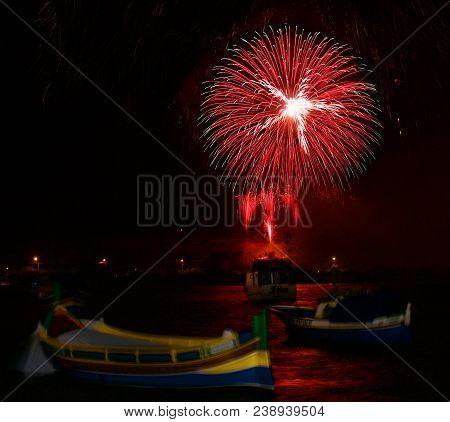 Red Pink Colorful Fireworks Explode In Malta In Dark Sky,malta Fireworks Festival, 4 July, Independe
