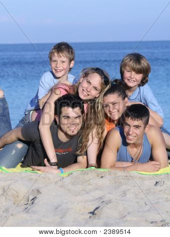 Extended Family On Summer Beach Vacation