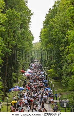Zagreb, Croatia - 01 May, 2018: Large Group Of People Walking Down The Walking Trail During The Inte