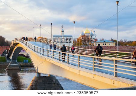 Veliky Novgorod, Russia - October 19, 2017. St Sophia Cathedral And People Walking On The Footbridge