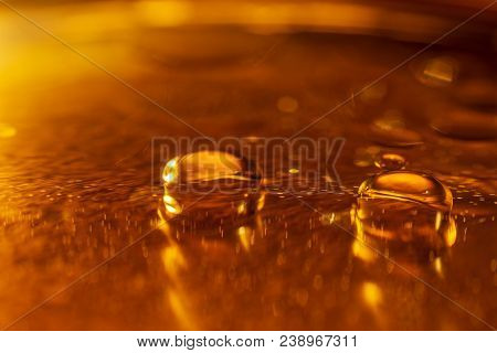 Oil Drops And Bubbles On A Metal Gear Engine Surface. Closeup Photo