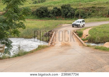 Winterton, South Africa - March 18, 2018: A Vehicle Is About To Cross The Single Lane Bridge Over Th