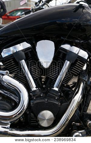 Closeup Photo Of V-type 2-cylinder Vee Twin Engine And Exhaust Pipes Of The Motorcycle