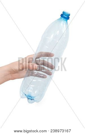 Female hand holding empty plastic bottle isolated on white. Recyclable waste. Recycling, reuse, garbage disposal, resources, environment and ecology concept. poster