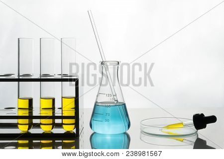 Laboratory Scene, Yellow Liquid In Test Tubes And Dropper, Blue Liquid In Flask.