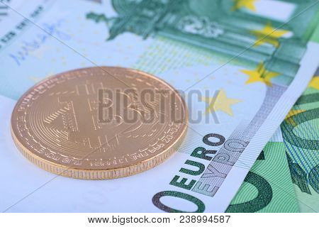 Macro Photo - Background Of The European Currency, The Euro, And Bitcoin.