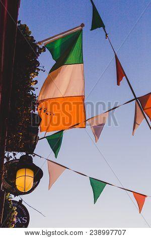 Dublin, Ireland - April 30th, 2018: Irish Flags Waving Off From The Rooftop Of An Irish Pub In Dubli