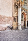 Bicycle and the Bab el-Mansour column, Morocco, Africa poster