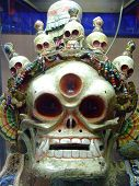Mongolian Ongghot mask in the 'Ulaanbaatar Monastery Museum Of Choijin Lama' in Mongolia used to scare away evil spirits. poster
