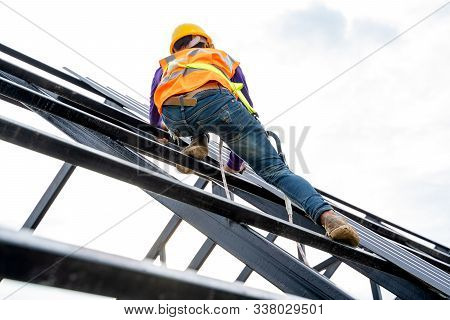 Construction Worker Wearing Safety Harness And Safety Line Working On High Roofing Work Instal New R