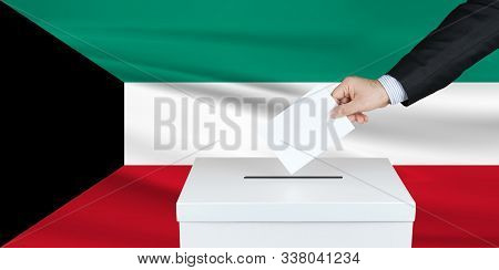 Election In Gaza. The Hand Of Man Putting His Vote In The Ballot Box. Waved Gaza Flag On Background.