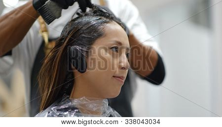 Woman with hair color dye in beauty salon