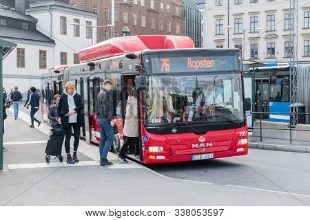 Stockholm, Sweden - September 24, 2019: Passengers Boarding A Red City Bus In Stockholm.