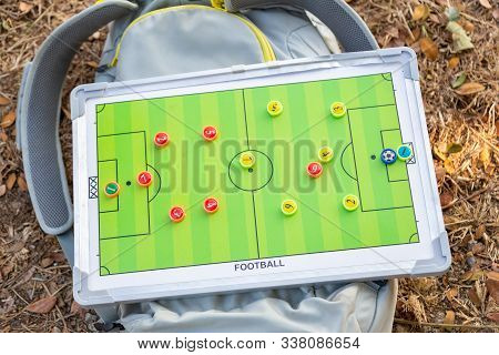 Magnet Tactic Game Plan Board Laying On A Bag At An Outdoor Game