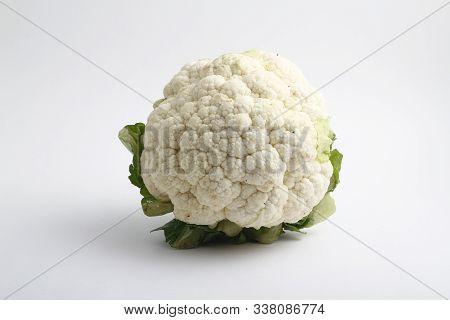 Raw Cauliflower, Whole Vegetable. Fresh Cauliflower, Isolated On White Background.