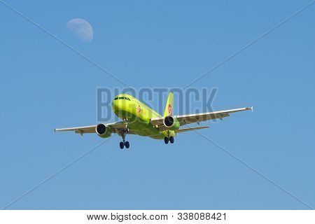 Saint Petersburg, Russia-may 13, 2019: Flying Plane Of The S7 Airlines And The Moon In The Blue Sky