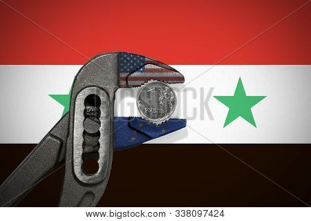 The Coin In Vise On The Background Of Flag Of Syria As A Symbol Of Economic Sanctions Against Of Rus