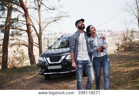 Positive People. Embracing And Enjoying The Nature. Couple Have Arrived To The Forest On Their Brand