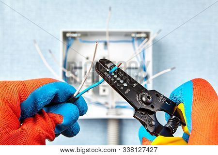 The Use Of The Stripper Cutter Tool To Strip The End Of The Electrical Wire When Repairing And Updat
