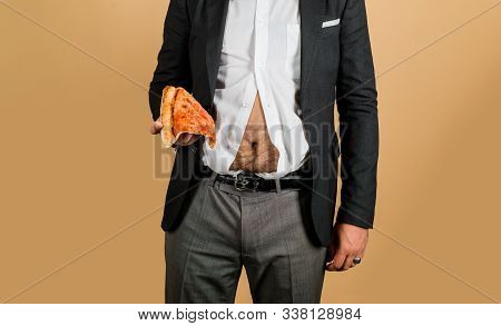 Fat Man With Piece Of Pizza In Hand. Obesity, Junk Food Concept. Fat Overweight Guy Hold Pizza. Heal