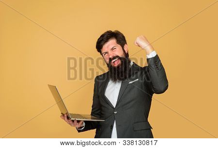 Handsome Businessman Working With Notebook. Office, Business, Technology, Internet. Man With Laptop