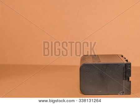 Lithium-ion Battery On Brown Background.