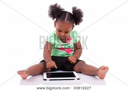 Little African American Girl Using A Tablet Pc