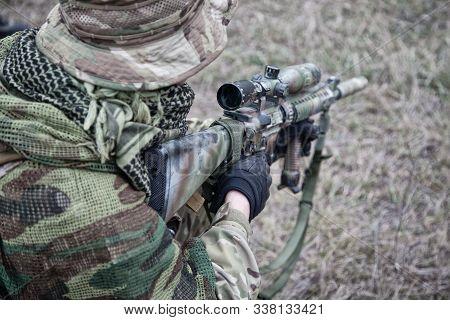 Kneeling Commando Army Soldier Marksman Over Shoulder View