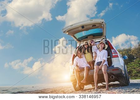 Holiday And Travel Family Concept, Summer Vacations . Happy Family Enjoying Road Trip With Their Fav