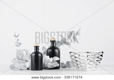 Contemporary Dressing Table With Blank Black Bottles With Beige Bungs, Metallic Bowl For Cosmetic De