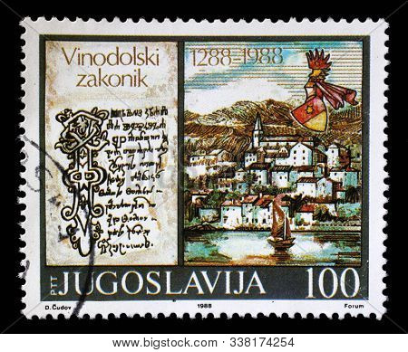ZAGREB, CROATIA - JUNE 21, 2014: A stamp issued in Yugoslavia shows Vinodol Law Codex, circa 1988.